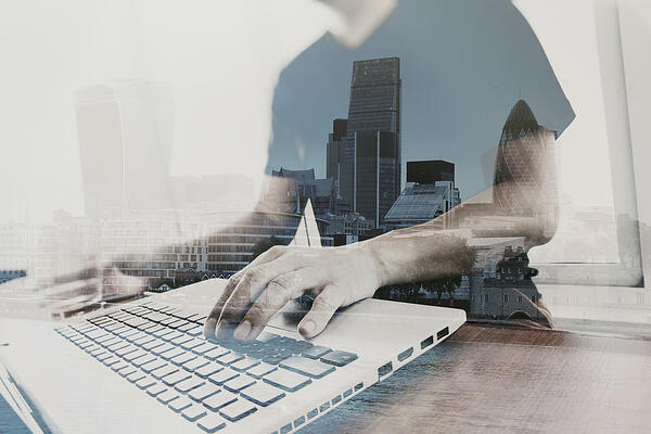 Double exposure of businessman working with new modern computer
